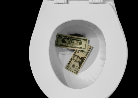 Bills in toilet bowls to show money being flushed