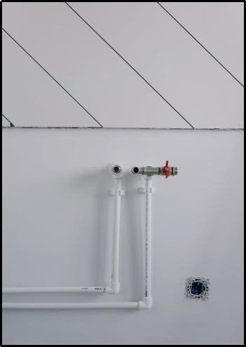pipes of radiator in an empty room